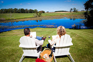 A couple enjoy their weekend getaway near Chicago, sitting outdoors and reading