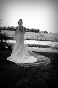 A bride stands off into the distance