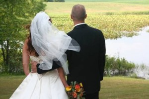 A Bride and Groom walk down the aisle