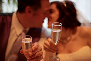 Newlyweds kiss over champagne