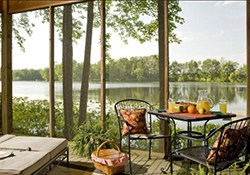 Breakfast is set for two on this screened in porch