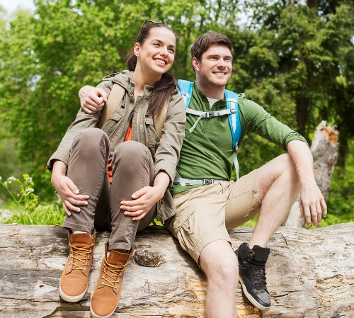 happy couple enjoying the best West Michigan hiking