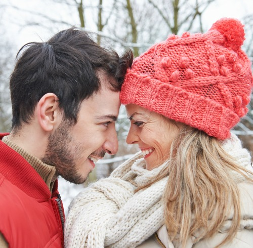 Happy couple embracing in winter