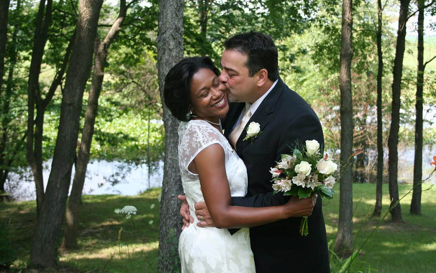 Groom Kissing Bride at Elopement in Michigan