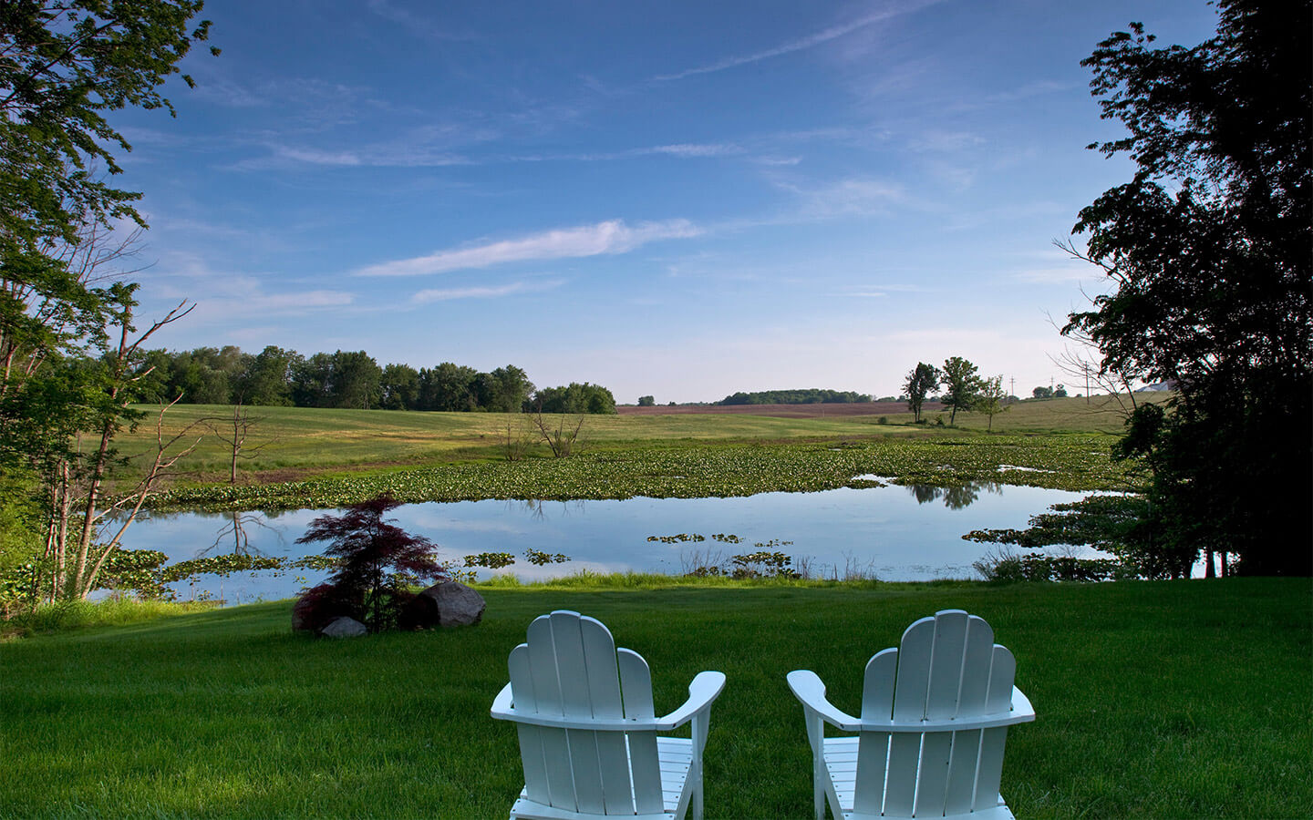 Chairs with a view of the pond at our romantic getaways in Michigan