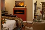 Bed with Fireplace in the Camelot Suite