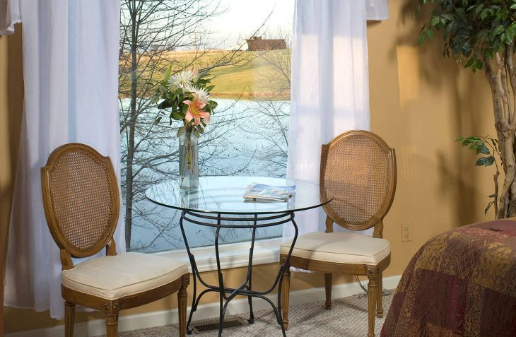 Chairs and table with view outside in King Arthur Suite