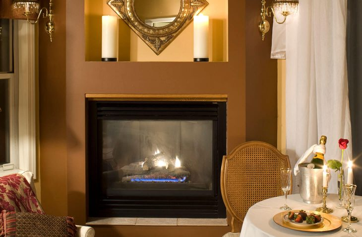 Romantic fireplace with wine in King Arthur Suite
