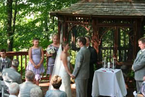 Wedding on the deck in front of the gazebo at Castle in the Country