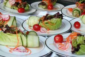 Plates of vegetables at a wedding reception