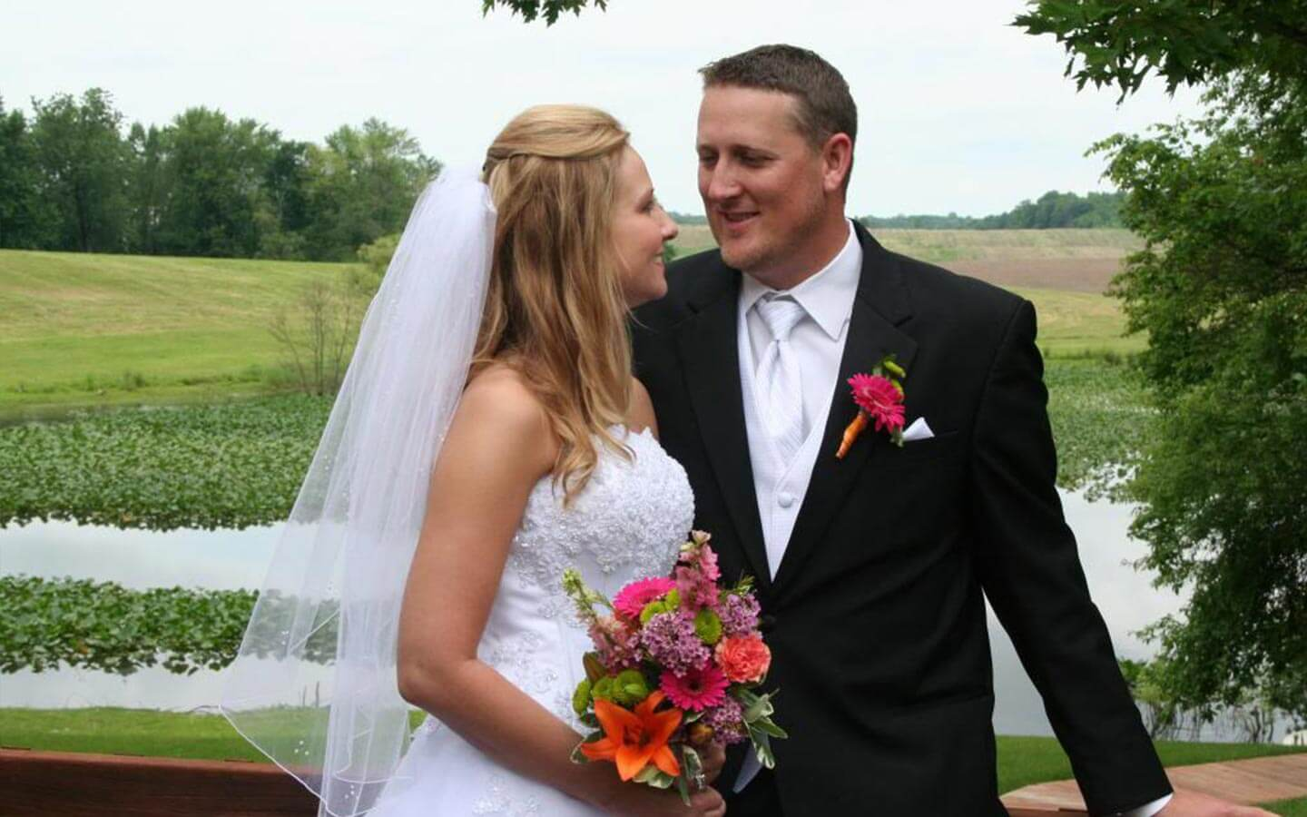 Destination wedding in Michigan, bride and groom looking at each other with smiles