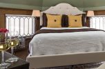 Romantic Michigan getaway, the Golden Tower room with Queen bed and wine glasses
