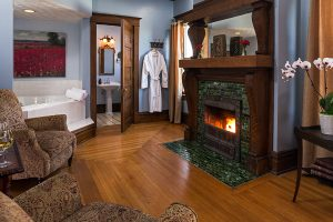 Kingdom Suite sitting area fireplace and Whirlpool tub