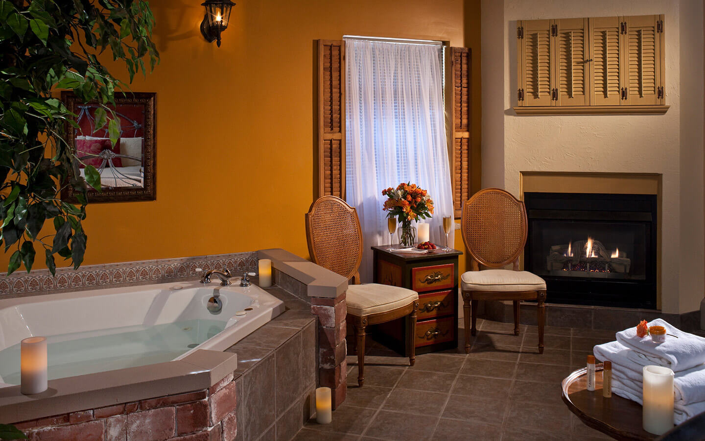 Romeo and Juliet Suite Whirlpool tub, side table, and fireplace