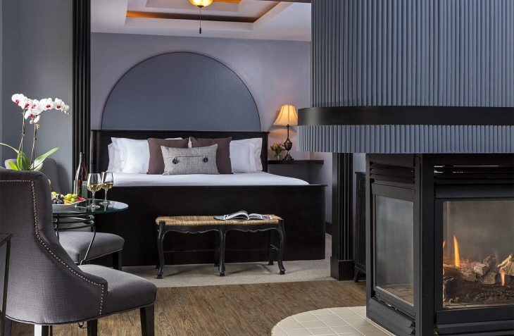Room over looking the king size bed and seating area with fireplace.