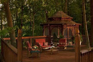Wooden deck with sitting area and gazebo