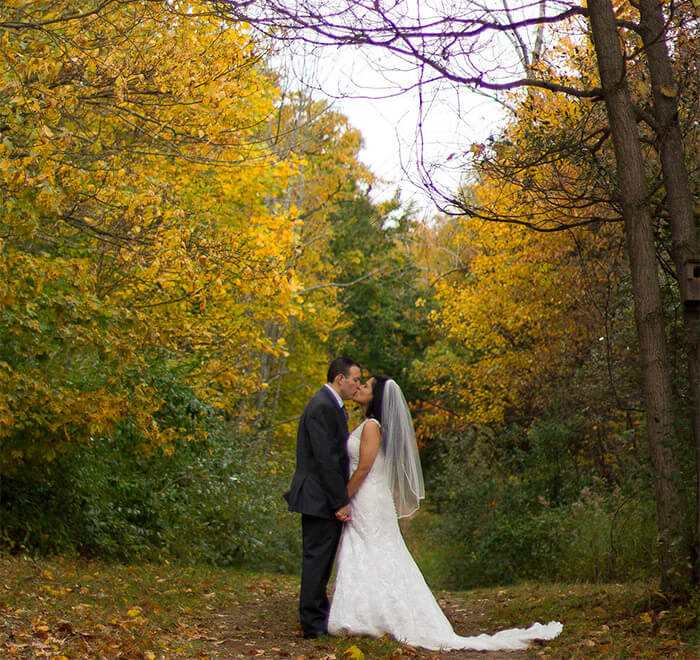 Couple Kissing at a Fall Wedding