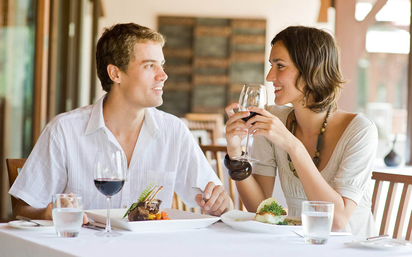 Michigan restaurant couple dining at table with wine
