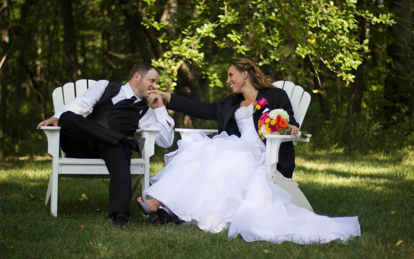 Allegan, Michigan Wedding bride and groom sitting on white chairs