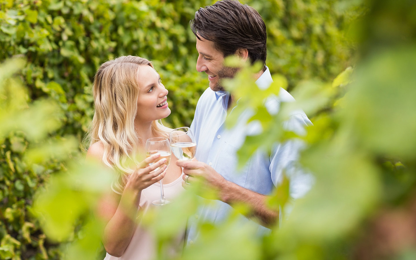 Couple toasting with wine at a winery in Michigan