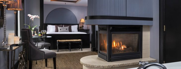 the Lancelot Room with fireplace, bed, and bathtub
