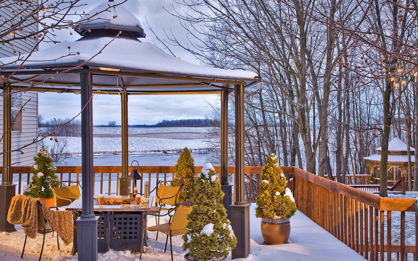 Romantic getaways in Michigan on the snowy deck with gazebo