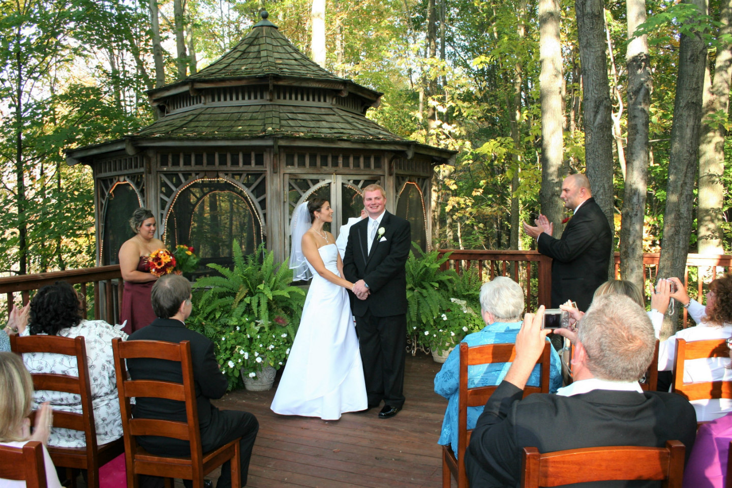 bride and groom on deck near gazebo