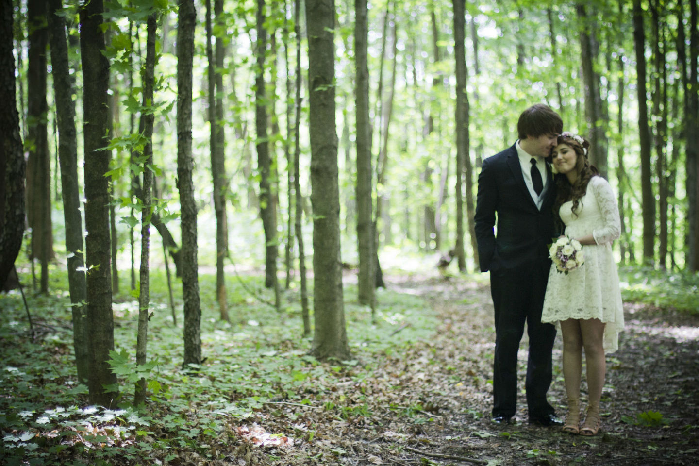 eloping couple in the woods