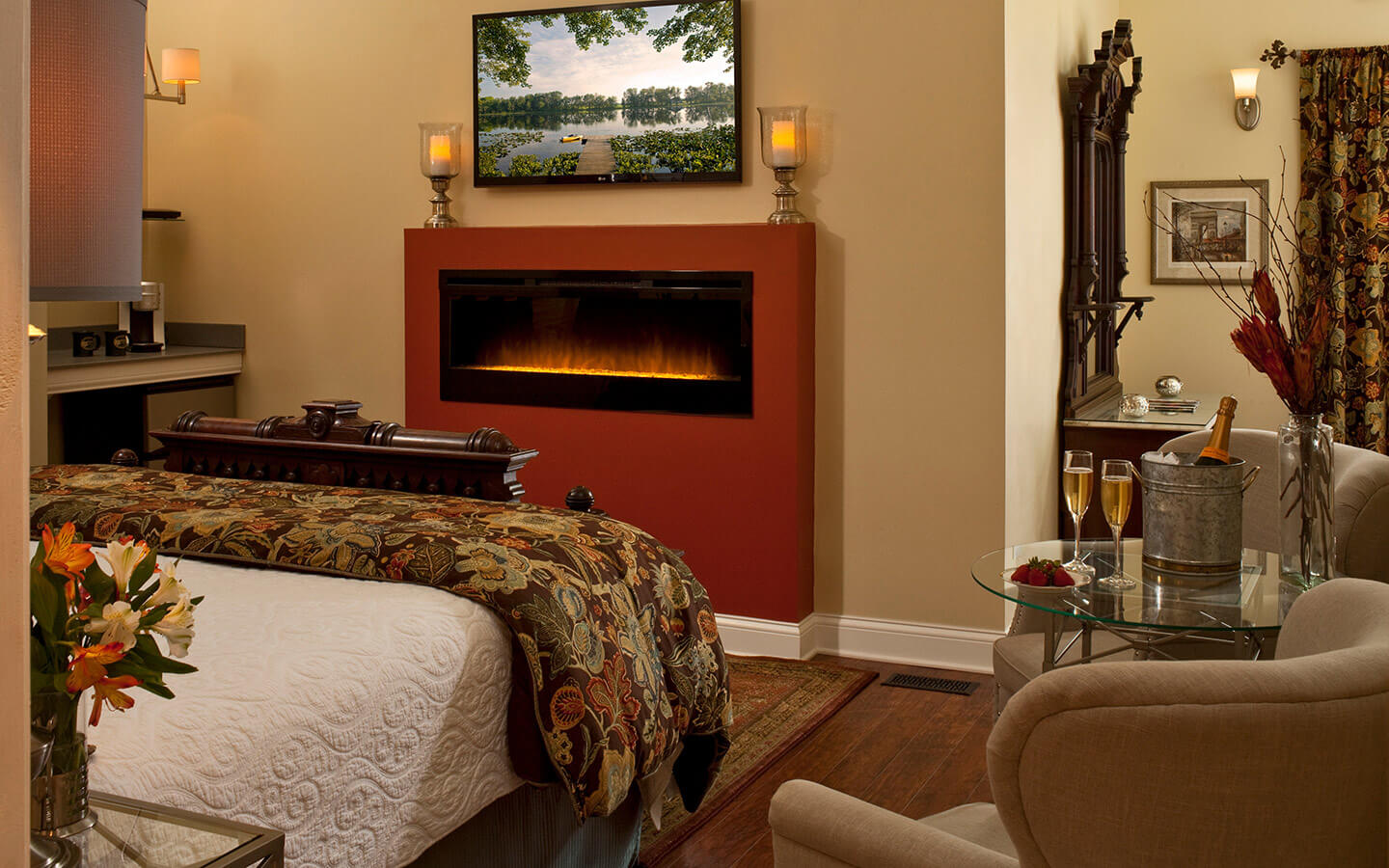 Camelot Suite with summer photo on TV and crystal fireplace