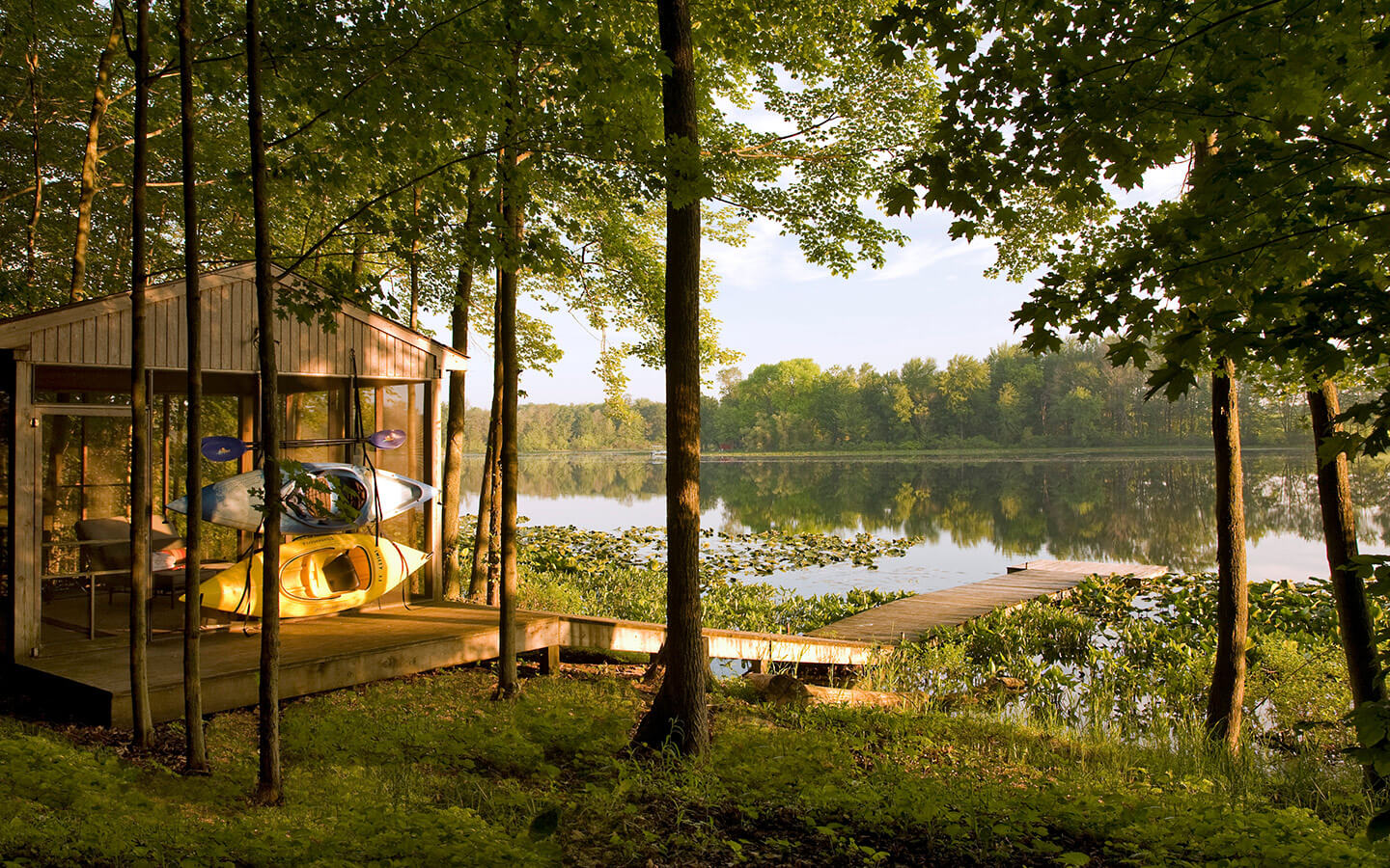 Screen house with kayaks by the lake