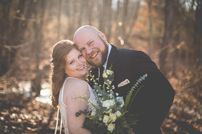 Smiling newlyweds in the fall