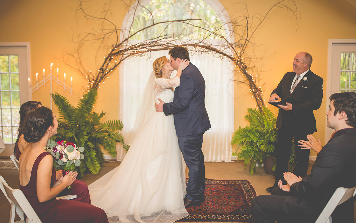 Michigan wedding, bride and groom kissing during an indoor ceremony
