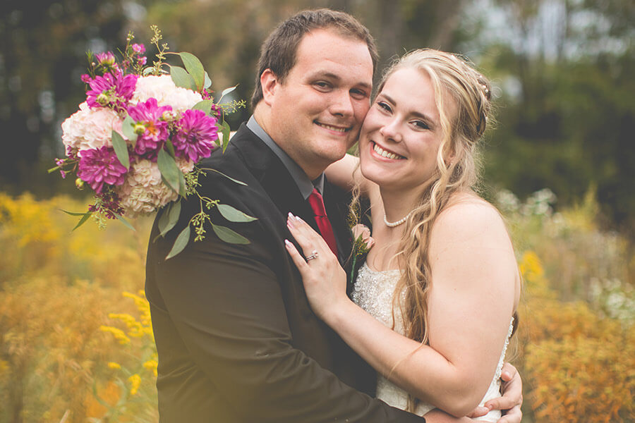 Smiling bride and groom in the spring