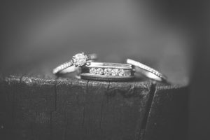 Black and white photo of wedding rings