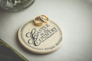 Wedding rings on the Castle in the Country logo