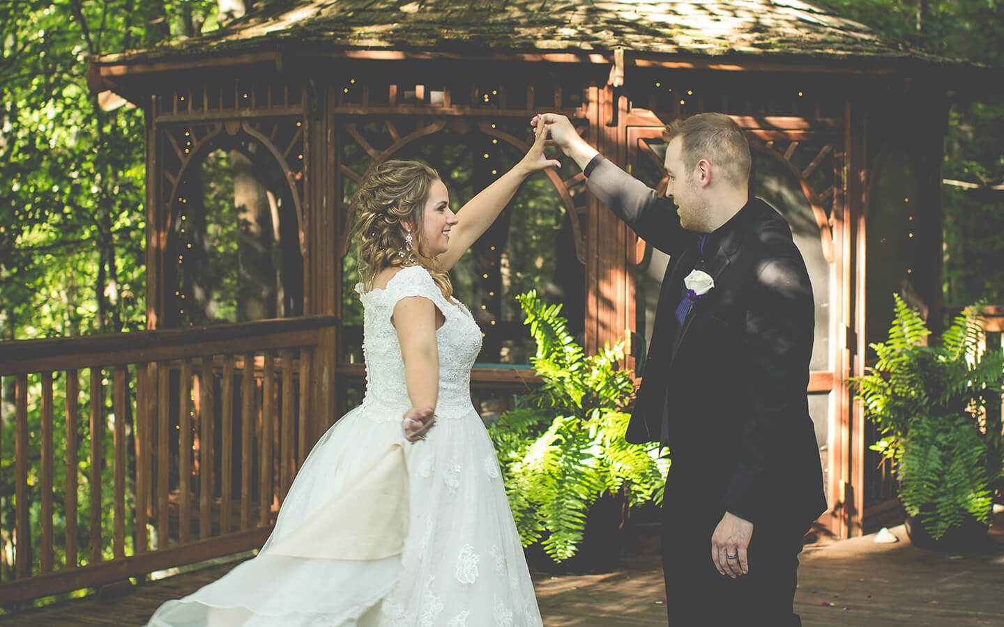 Bride and groom dancing in front of a gazebo at our destination wedding location in Michigan