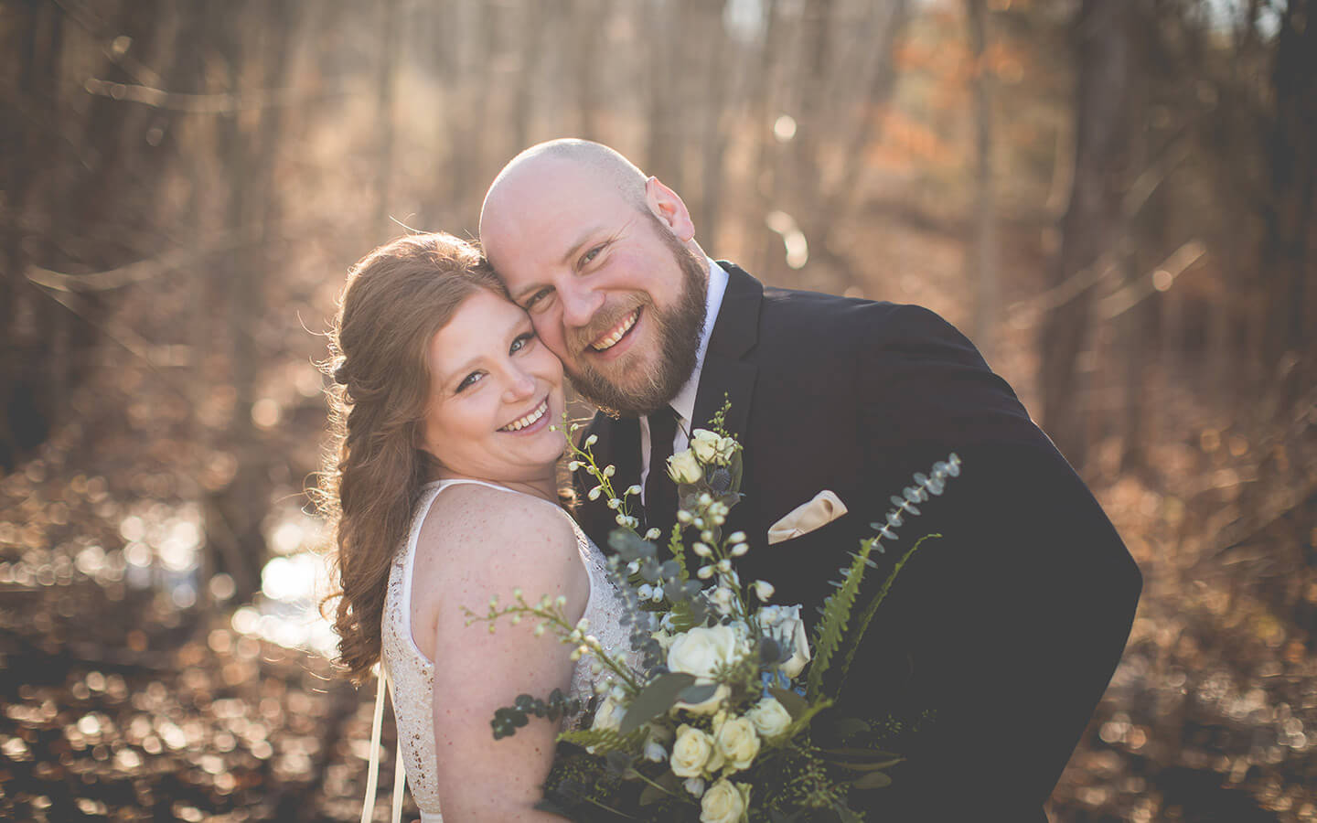 Destination wedding in Michigan, Smiling bride and groom on a sunny fall day