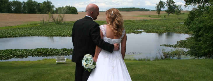 Wedding couple looking at a pond