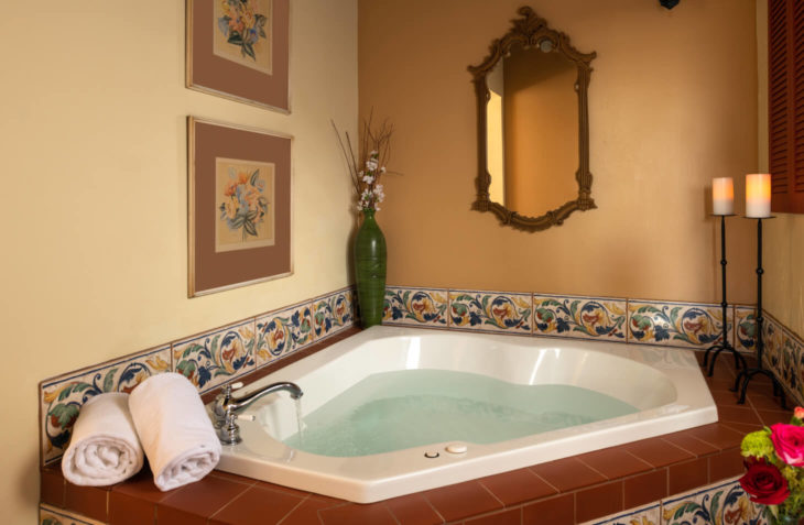 Two person whirlpool tub with a terracotta roof feature.