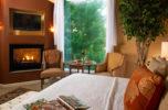 King Arthur Room with Fireplace, Flatscreen, and Large Window