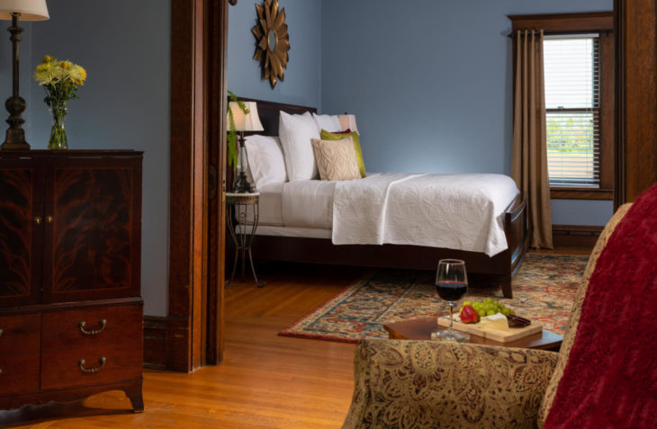 Bedroom view with pocket doors and a king size bed