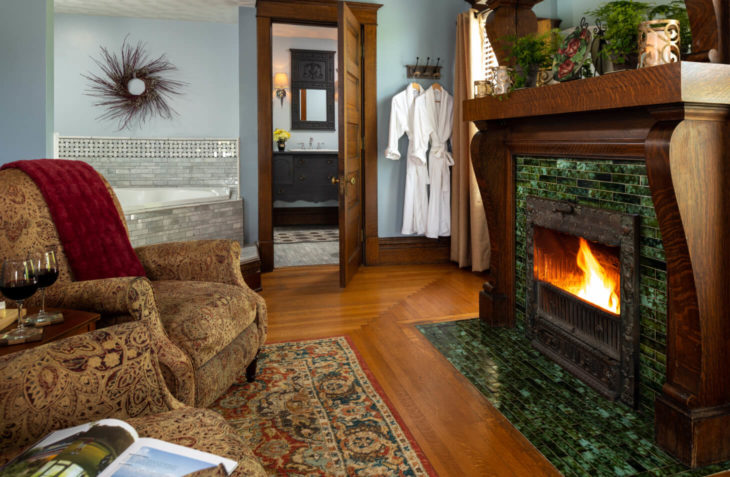 original wood burning fireplace view with seating area.