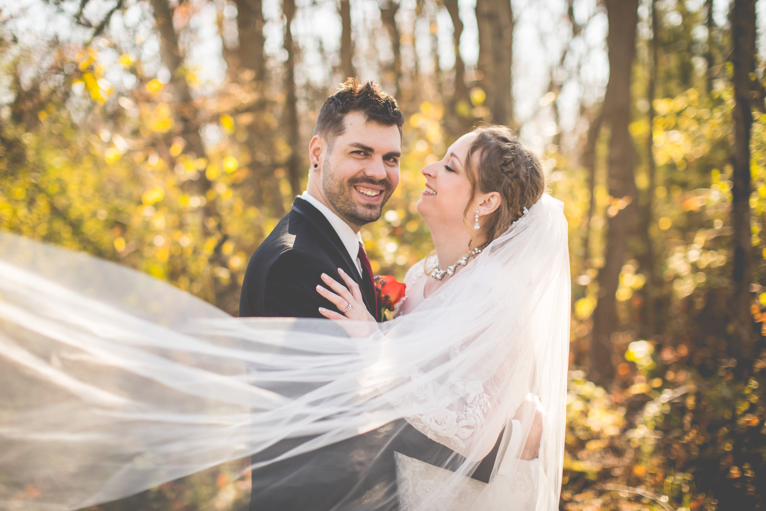 Couple Embrace at Outdoor Elopement in Michigan