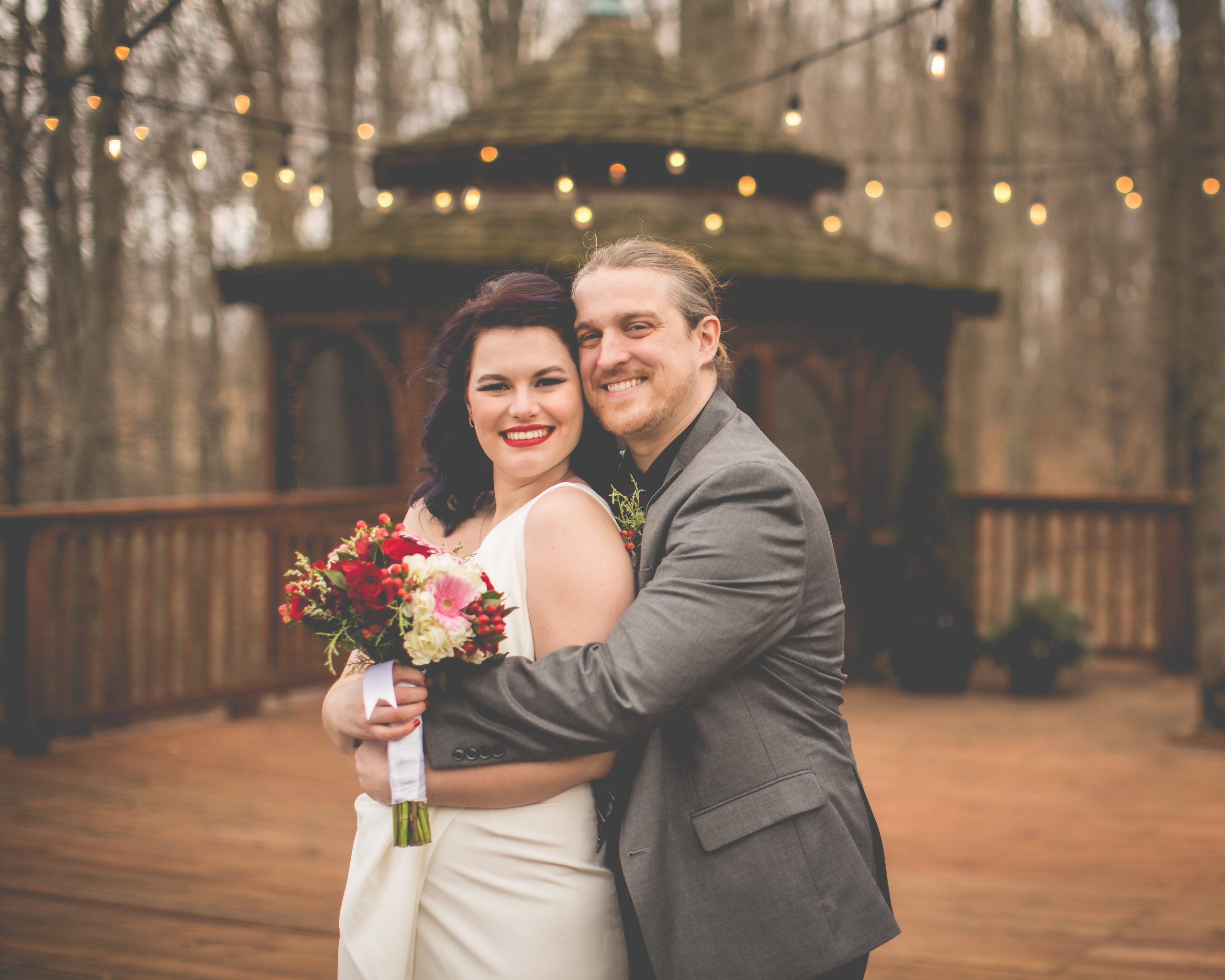 Michigan Wedding, bride and groom embrace on gazebo deck