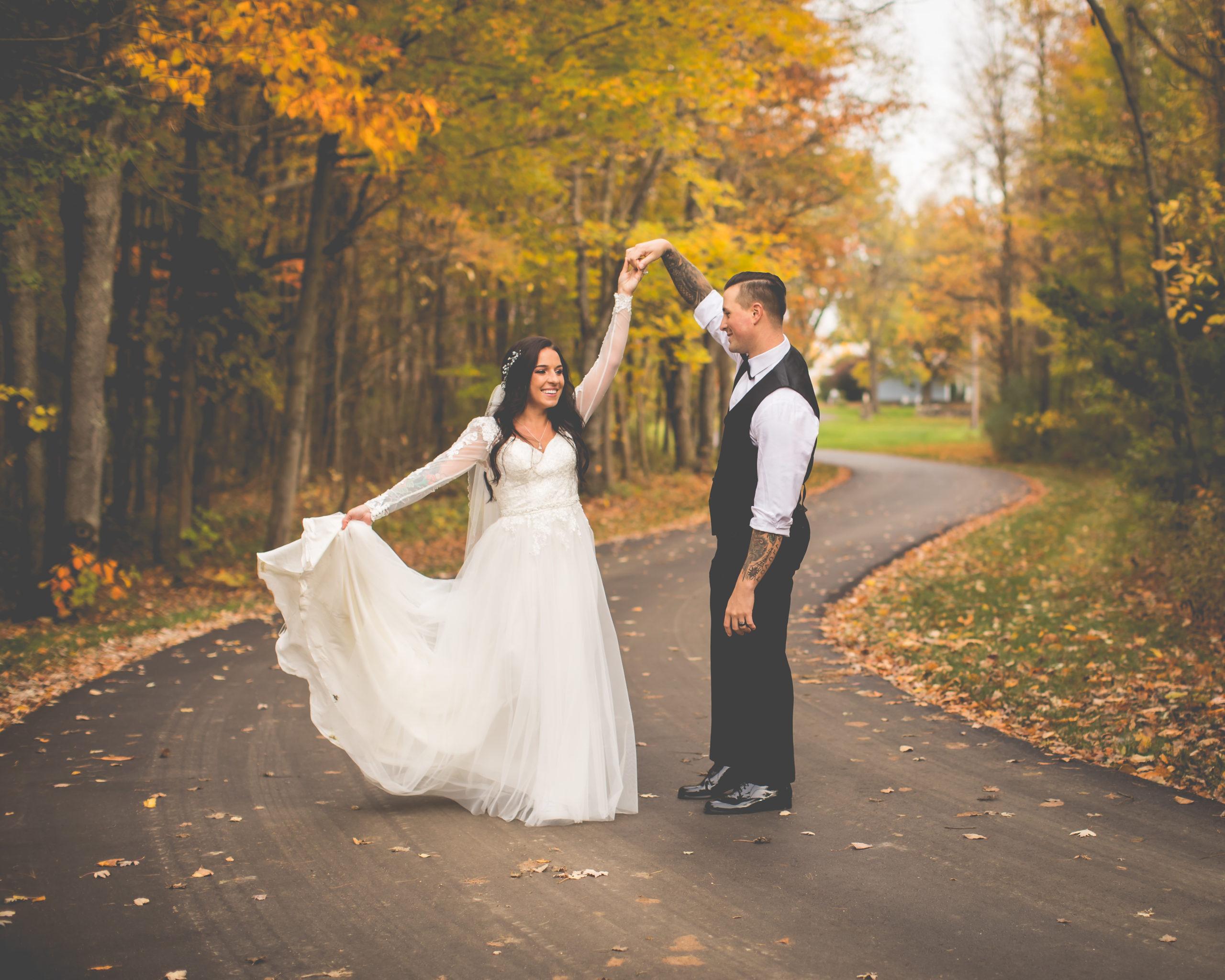 Wedding couple dancing on pathway