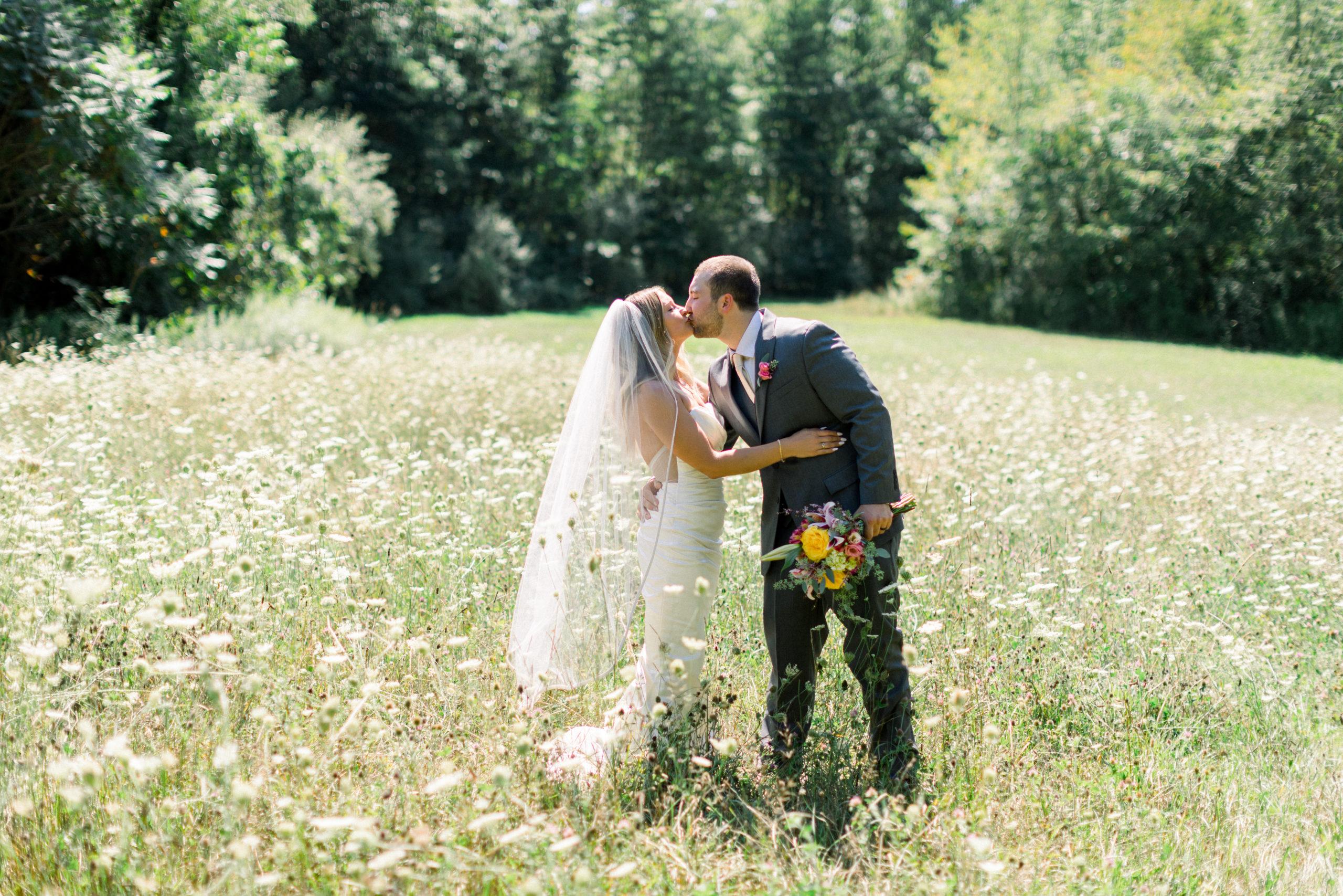 Couple kiss in field of flowers