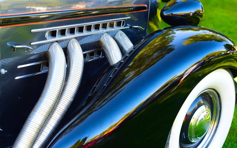 Shiny black vintage car with chrome trim