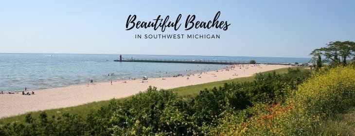 Overlook of South Beach in South Haven, sandy beach, Lake Michigan in the distance and grass on the dunes