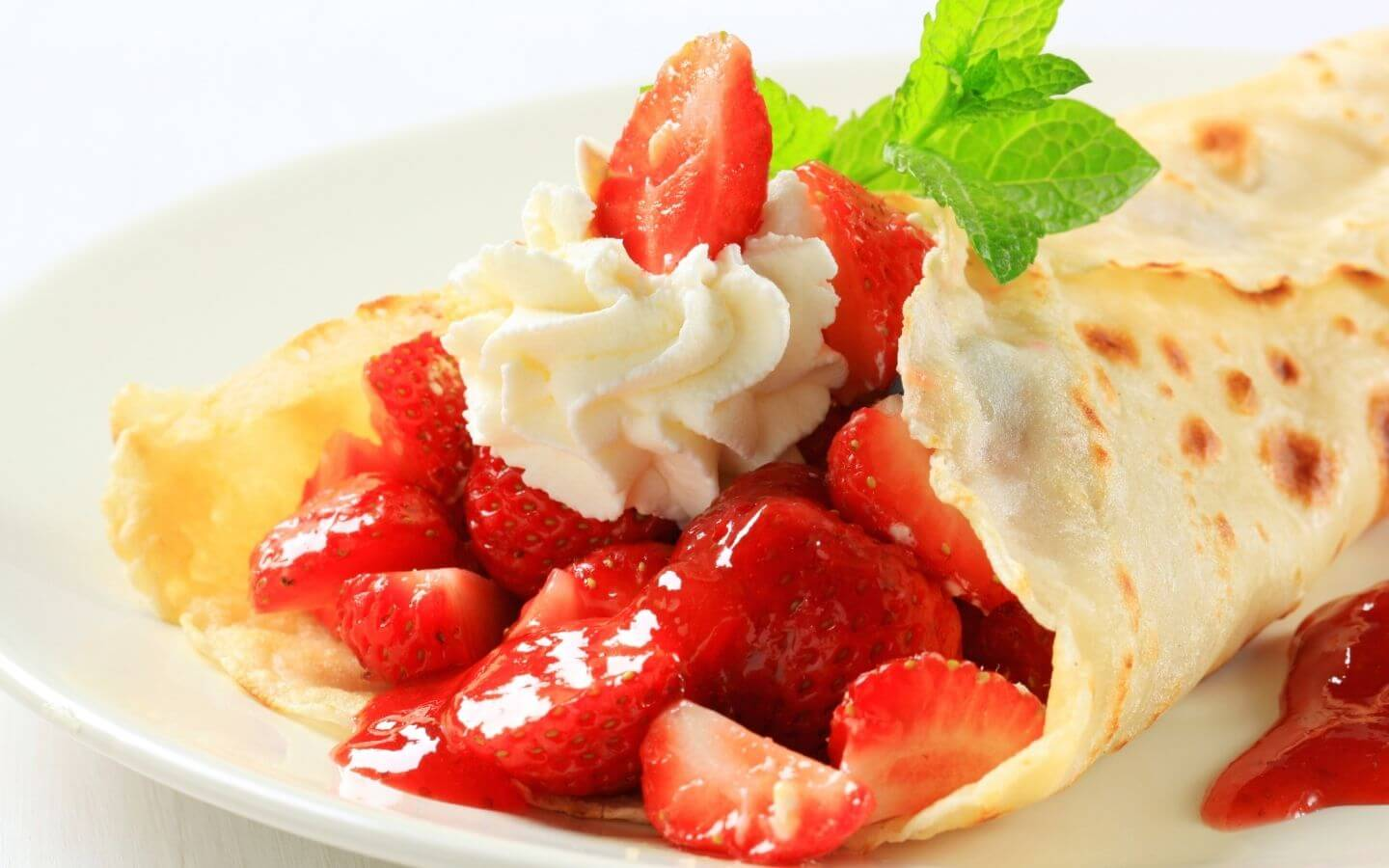 Strawberry and rhubarb filled crepes