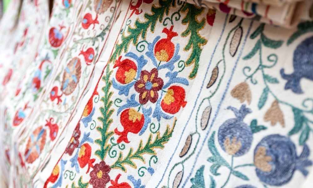 Beautiful hand-stitched white cloth in red, green and blue